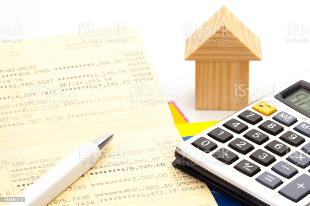 Bank book, a calculator, a pen, The concept of financial planning to buy a home. Financial tools stock photo