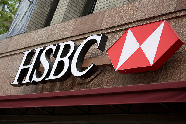 """HSBC Bank Branch in downtown Seattle """"Seattle, Washington, USA - May 27, 2012:  The word mark and logo of HSBC Bank in downtown Seattle, is situated above the entrance to the local branch."""" hsbc stock pictures, royalty-free photos & images"""