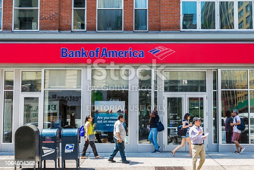 New York City, USA - July 26, 2018: Facade of a bank branch of Bank of America on the street with people around in New York City, USA