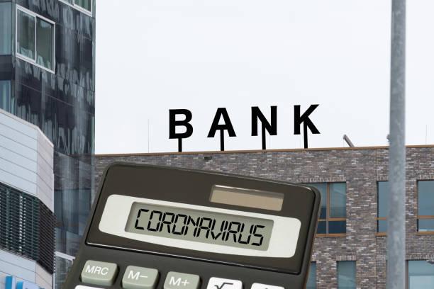 Bank, calculator and coronavirus stock photo