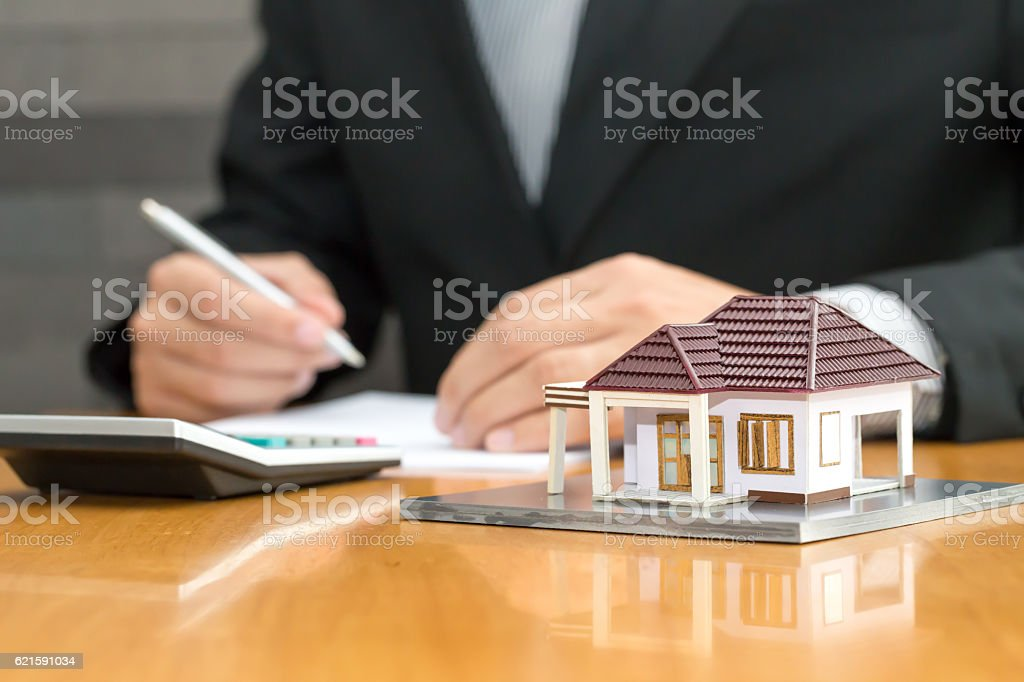 Bank checking accounts with a calculator, loan to buy home stock photo