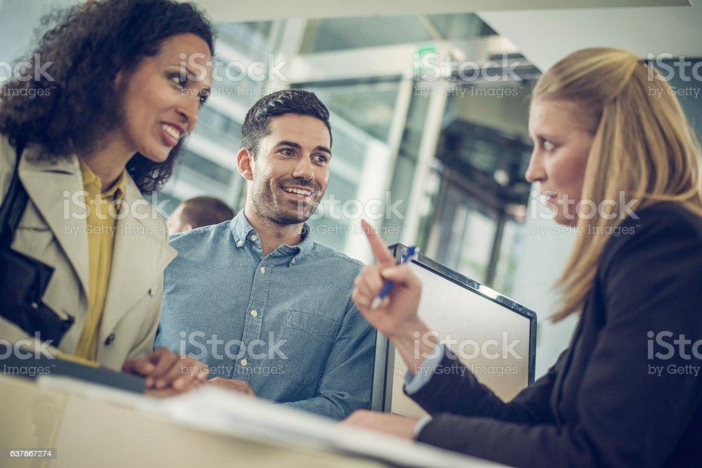 Bank employee explaining loan details to a couple - Photo