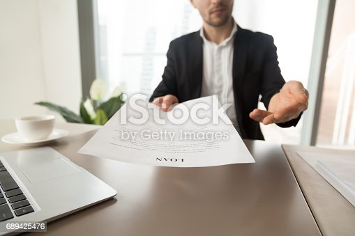 istock Bank employee offers to read loan agreement form 689425476