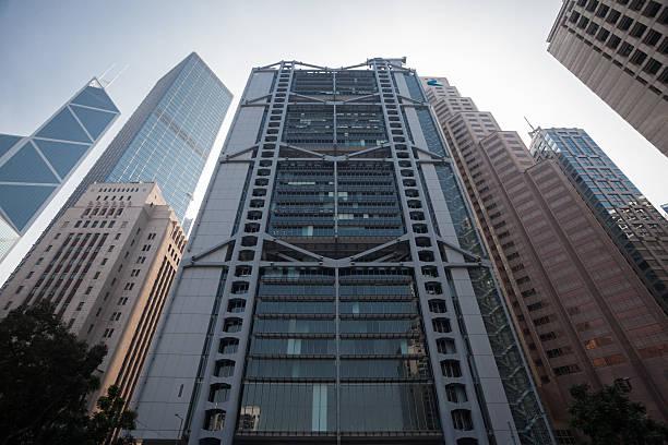 Bank Headquarters in Hong Kong Hong Kong, Hong Kong S.A.R. – January 12, 2014: The photo shows several bank headquarters like HSBC or Bank of China in Hong Kong at noon. hsbc stock pictures, royalty-free photos & images
