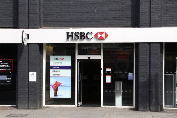 Bank in London LONDON, UK - JULY 6, 2016: HSBC Bank branch in London. HSBC was established in Hong Kong in 1865. Currently it is headquartered in the UK. hsbc stock pictures, royalty-free photos & images