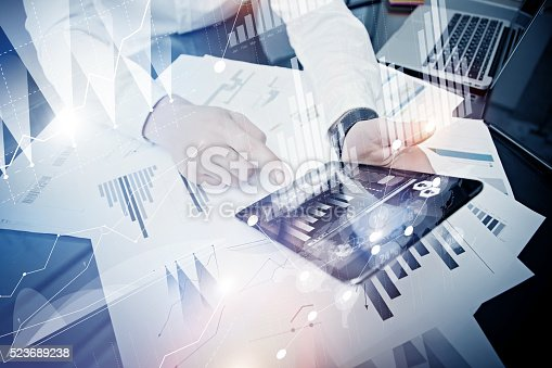 533699494istockphoto Bank manager working process.Closeup photo trader work market report 523689238