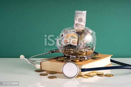 Piggy bank and stethoscope with insurance concept.