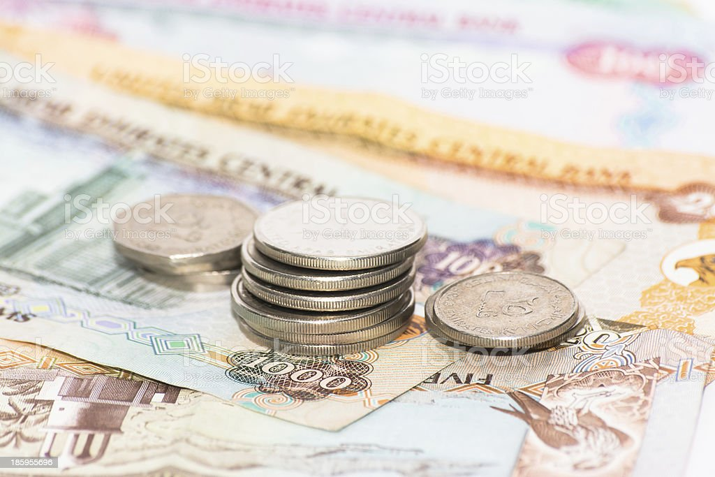 UAE bank notes with coins royalty-free stock photo