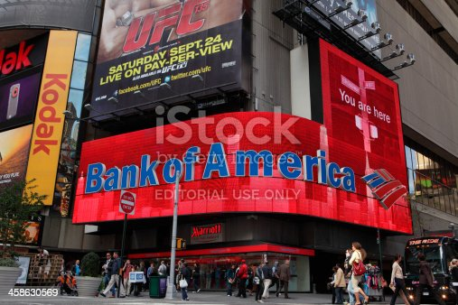 New York, NY, USA - September 17, 2011: Video LED display on the exterior of the Marriott Hotel between 45th and 44th Streets on Broadway in Times Square advertising Bank of America above a bank location. Bank of America  is currently one of the four largest banks in the USA. Billboard adverts dfor Kodak, and UFC (Ultimate Fighting Championship) can also be seen. Shoppers and tourists walk the sidewalks.