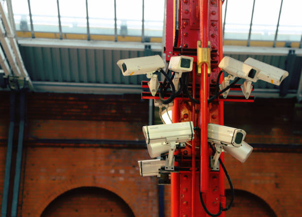 bank of cctv cameras - big brother orwellian concept stock pictures, royalty-free photos & images