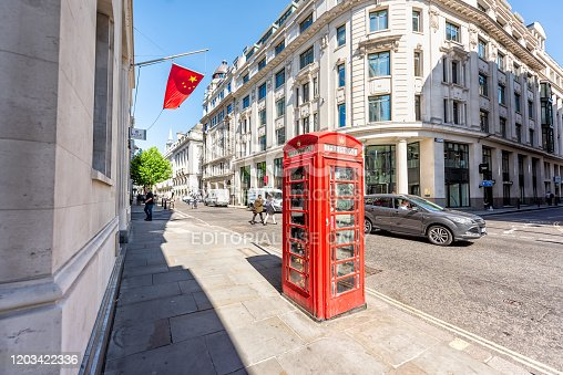 London, UK - June 26, 2018: Bank of china in business center architecture wide angle view with red telephone booth
