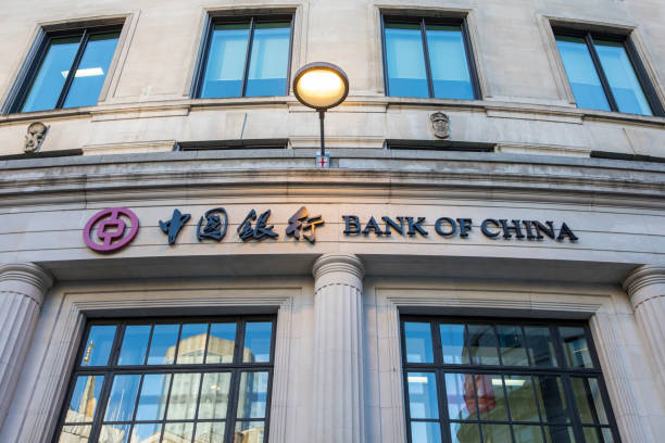 Bank of China in London London, UK - February 15th 2019: The Bank of China logo on the exterior of a building in the City of London, UK.  The Bank of China is one of the four biggest state-owned commercial banks in China. bank of china stock pictures, royalty-free photos & images