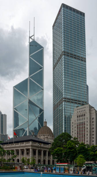 Bank of China Tower and the Cheung Kong Center Hong Kong, China - August 17 2007: Old Supreme Court Building and the Bank Of China Building dwarfed by the Bank of China Tower and the Cheung Kong Center. bank of china stock pictures, royalty-free photos & images