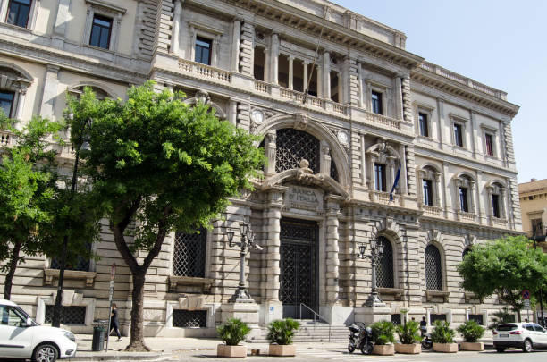 Banca D'Italia, Palermo, Sicily PALERMO, ITALY - JUNE 16, 2018:  Imposing facade of the offices of the Banca D'Italia in Palermo, Sicily.  Seen on a sunny summer afternoon. monetary policy stock pictures, royalty-free photos & images