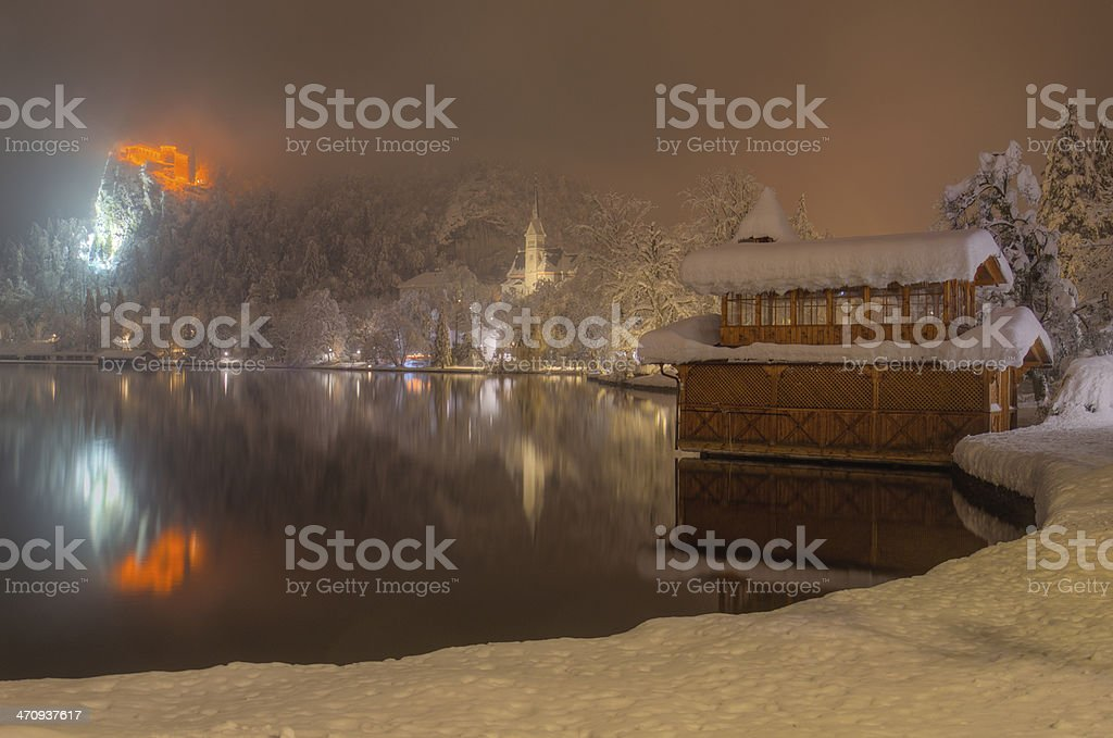 Bank Of Lake Bled In Winter Snowy Night Stock Photo