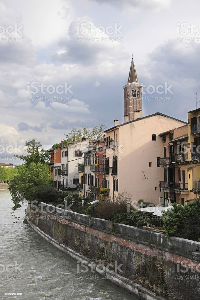 Bank of the river Etsch and church royalty-free stock photo