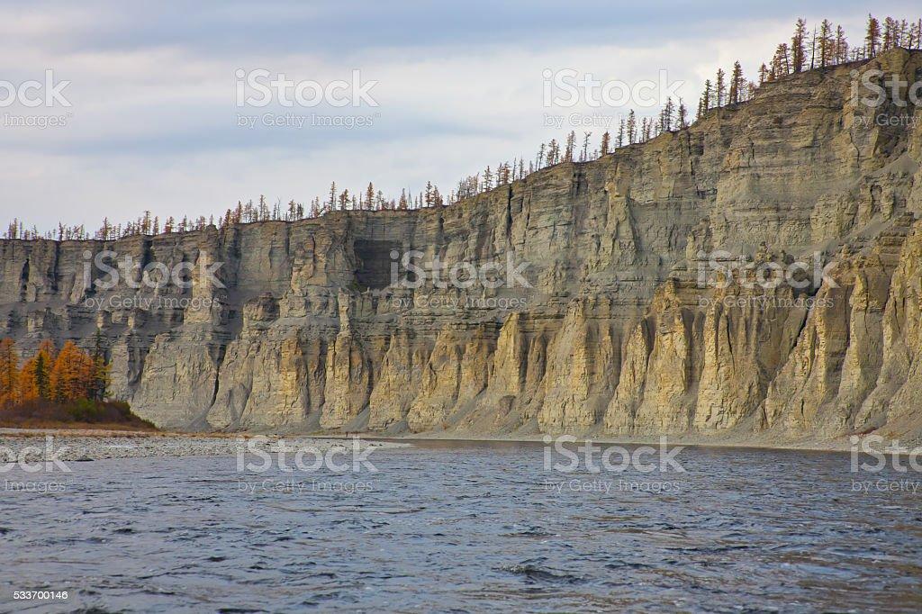 Bank of the river  Moierokan and Siberian taiga in the autumn stock photo