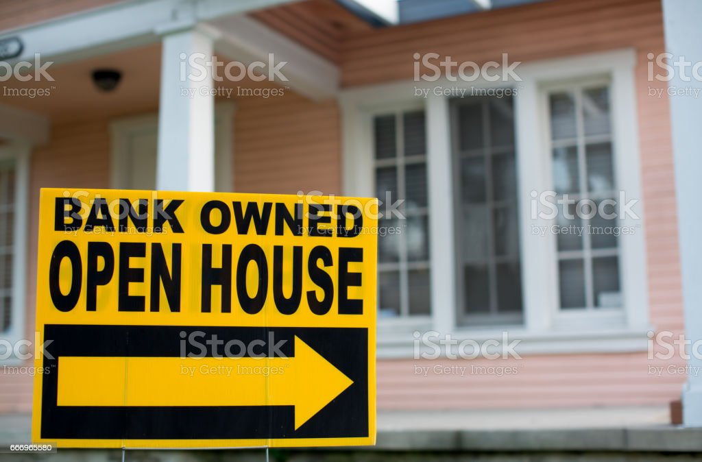 Bank Owned Open House Sign. In Front of a Home stock photo