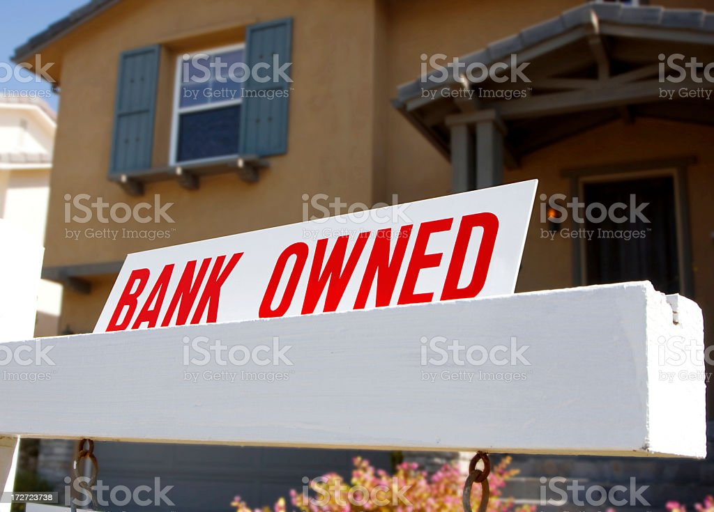 Bank owned A real estate sign that says bank owned. Adversity Stock Photo
