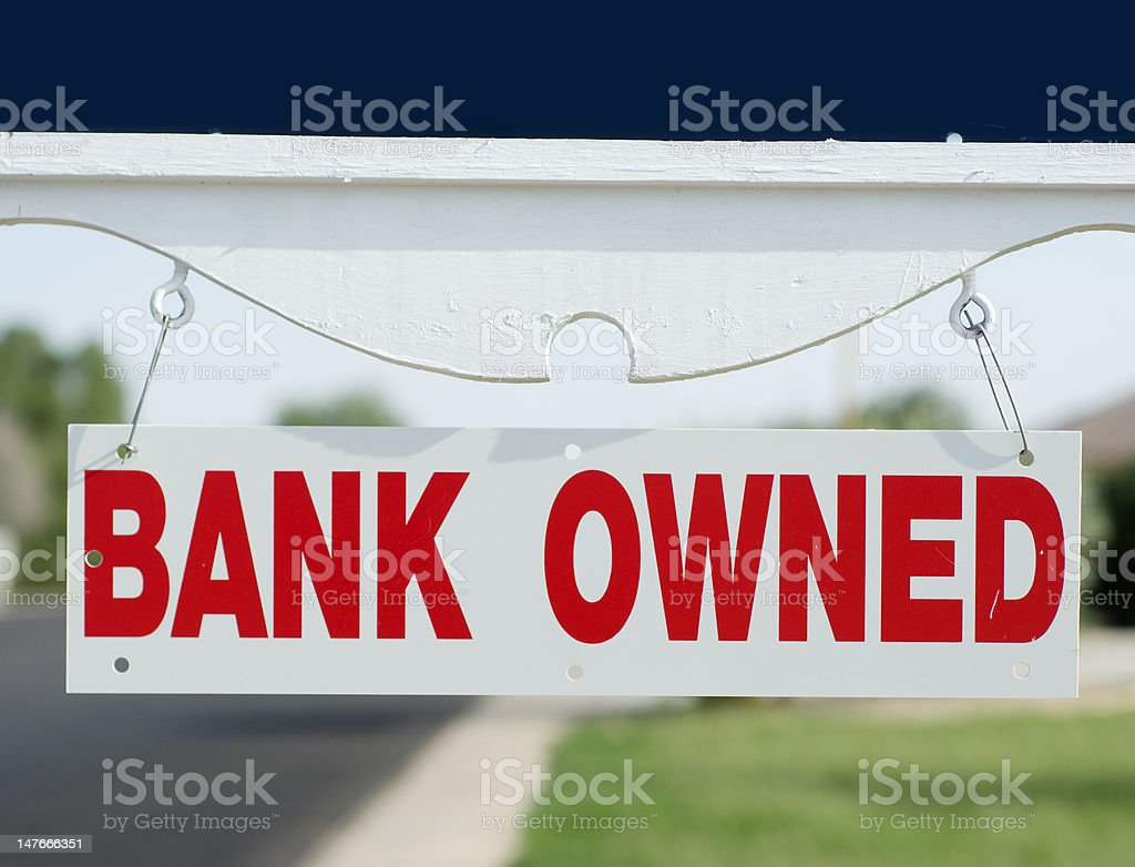 Bank owned real estate sign stock photo