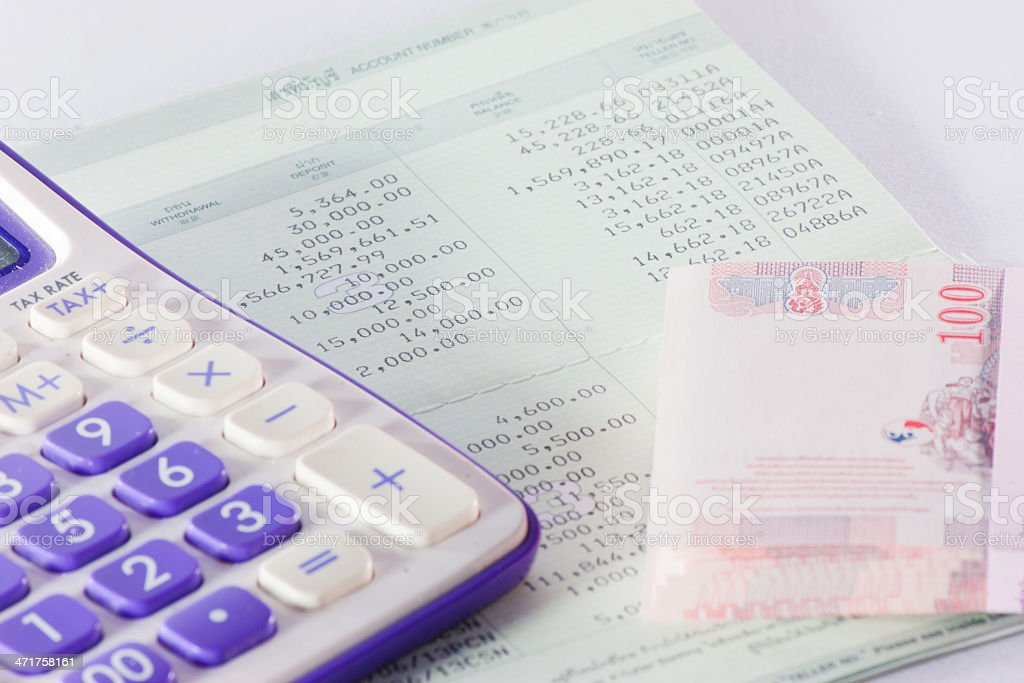 bank passbook with  part of calculator and money close up stock photo