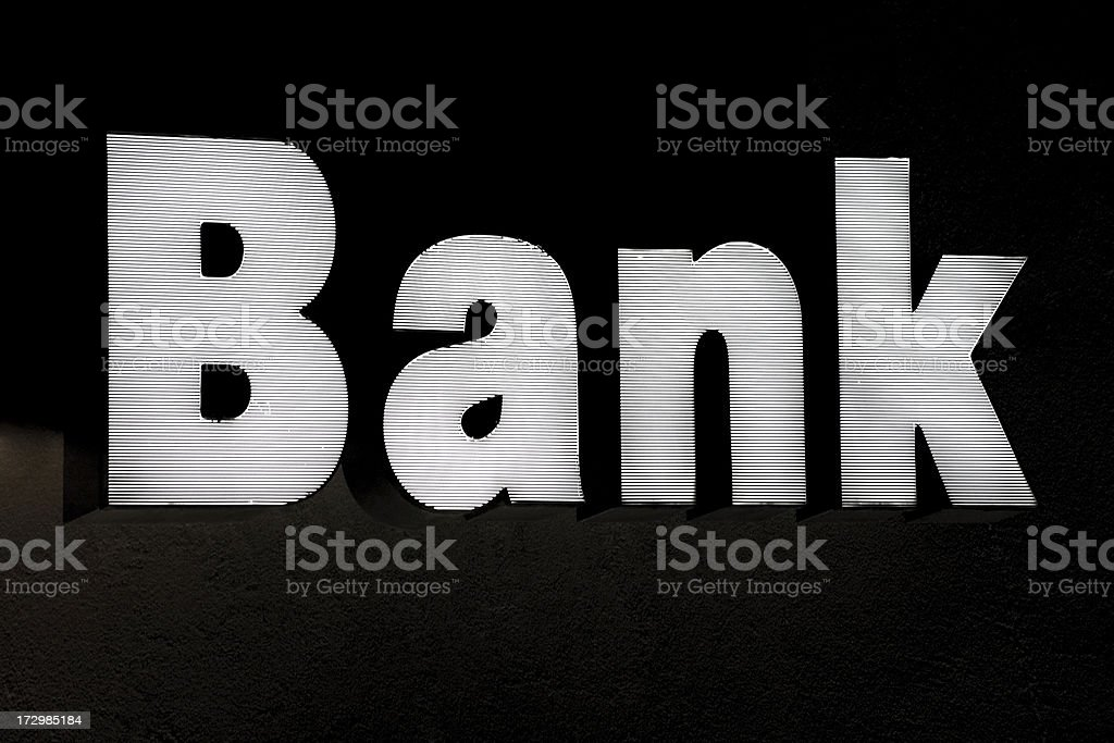 bank sign illuminated at night royalty-free stock photo