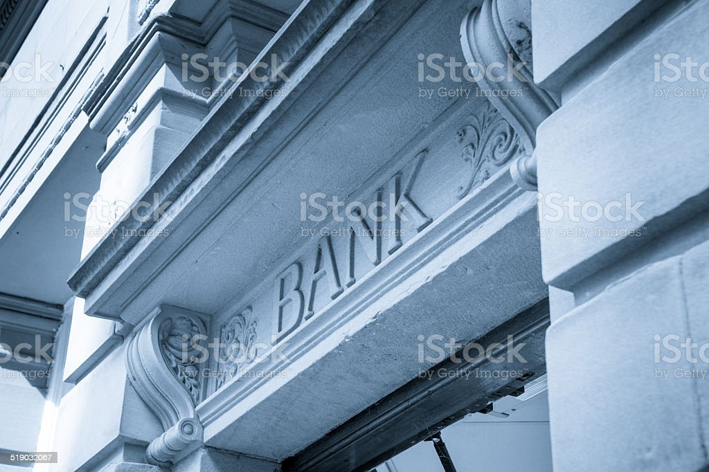 Bank Sign logo entrance, Stone Background stock photo