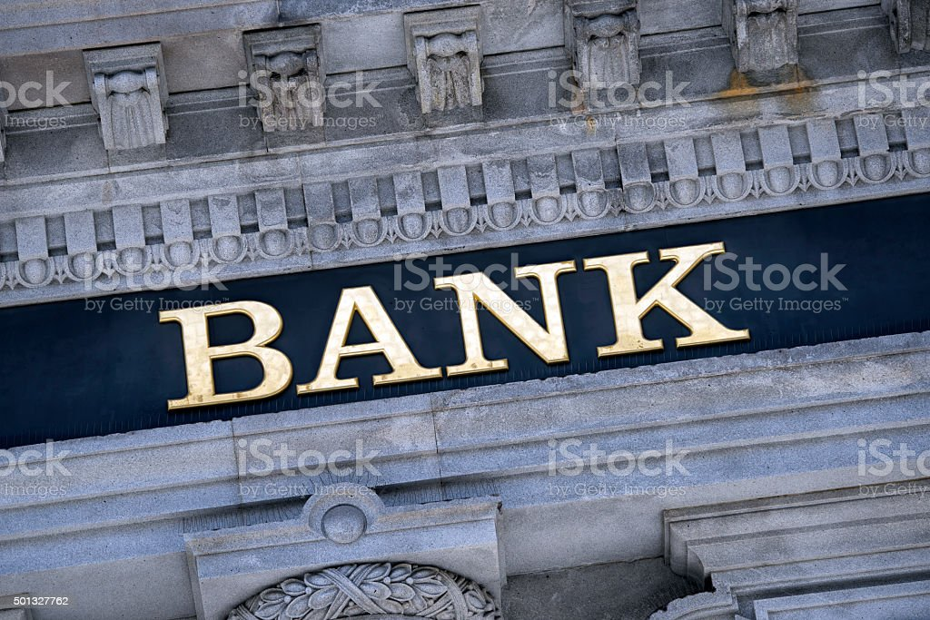 Bank sign on a building exterior. stock photo