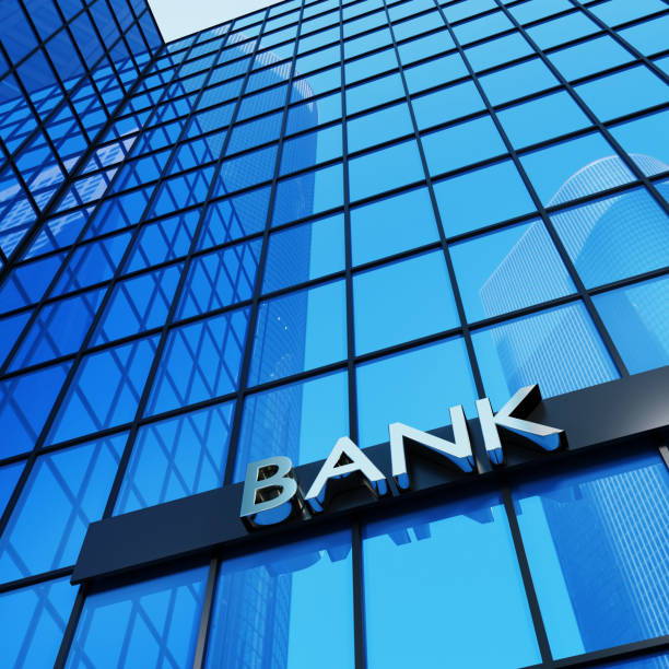 cartello bancario su un moderno edificio in vetro. rendering 3d. - banca foto e immagini stock