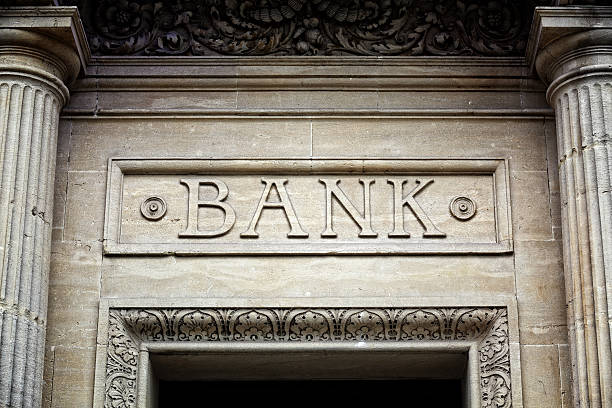 Bank sign on building stock photo