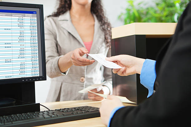 Bank Teller and Customer Banking Transaction in Retail Bank Counter stock photo