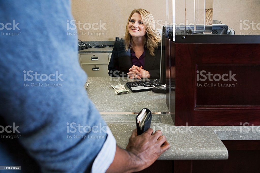 Bank teller working in bank stock photo