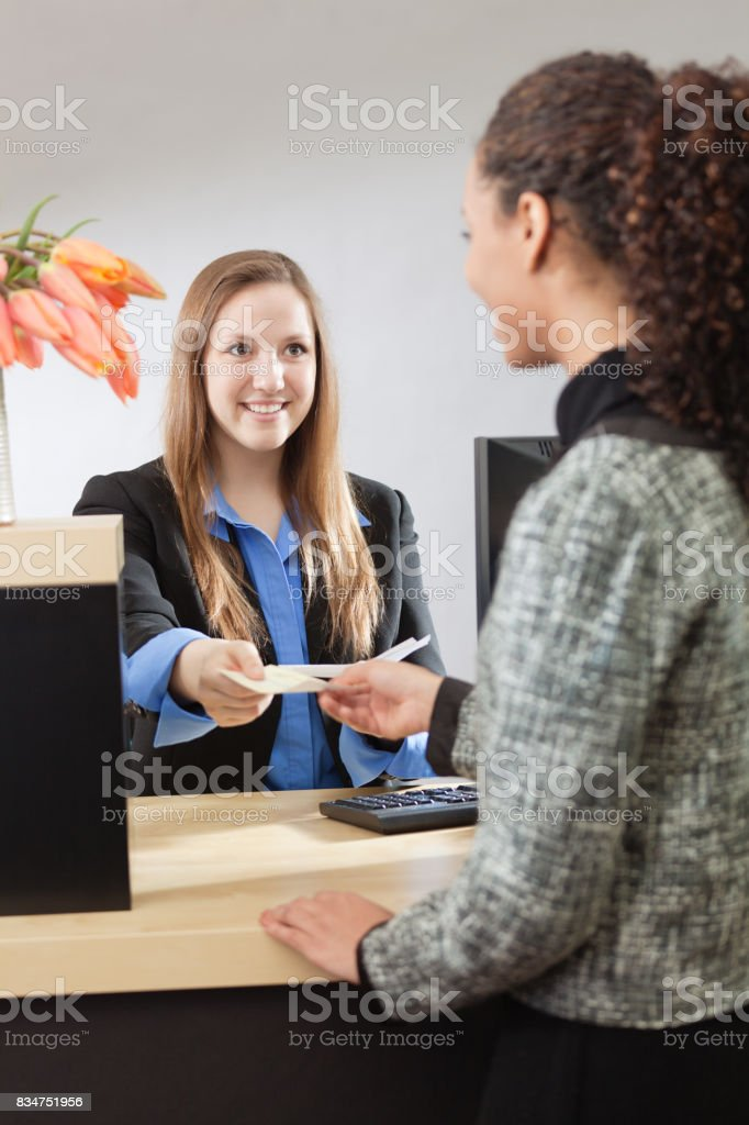 Bank Teller Working with Customer at Retail Bank stock photo