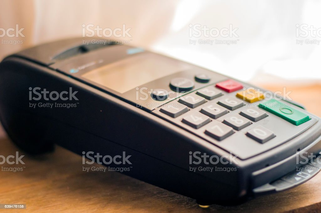 Bank terminal and payment card in the office interior. stock photo