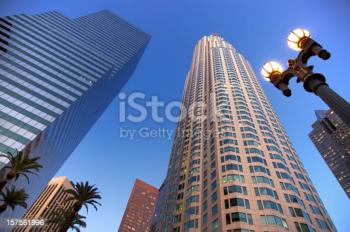 US Bank tower in downtown Los Angeles, California looking up to skyscrapers from directly below at dusk, some slight vignetting