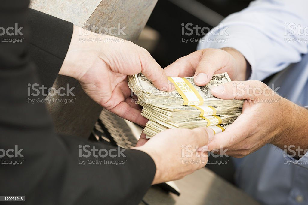 Bank transaction: large sum of money exchanging hands royalty-free stock photo