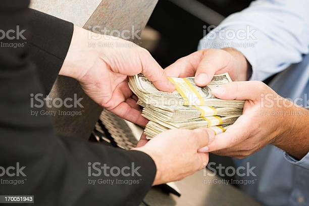 Bank transaction: large sum of money exchanging hands Bank transaction: large sum of money exchanging hands. You might also be interested in these: American One Hundred Dollar Bill Stock Photo