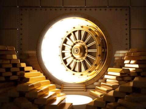 Bank vault full of gold ingots with half open door.Similar: