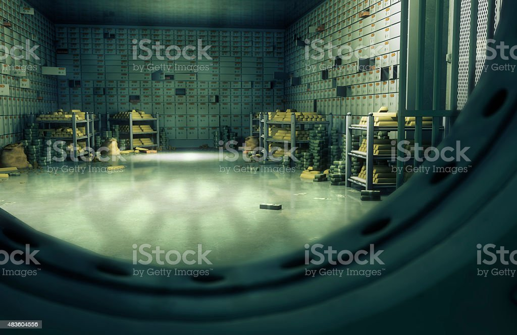 Bank vaulted door with safety deposit boxes stock photo