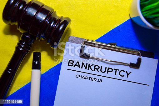 istock Bankcrupty Chapter 13 text on Document form and Gavel isolated on office desk. 1179491489