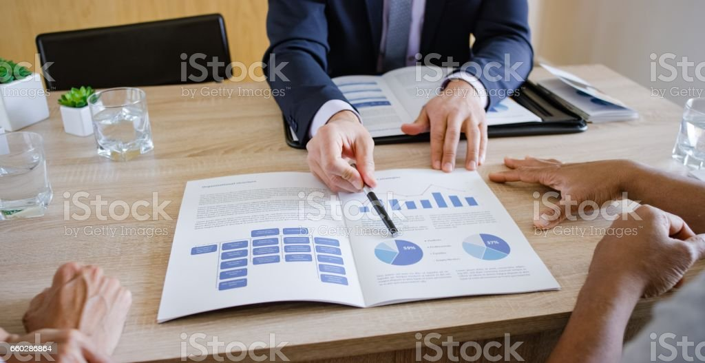 Banker discussing with couple stock photo