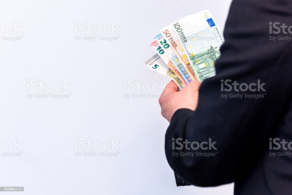 Banker holds Euro banknote cash in his hands foto royalty-free