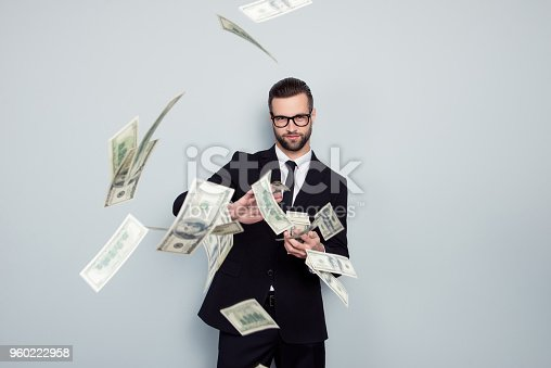 istock Banker increase profit lottery jackpot shower waste posh chic classy wealthy stack dealer dealing costly throw expensive concept. Proud arrogant tricky handsome guy sharing money isolated background 960222958