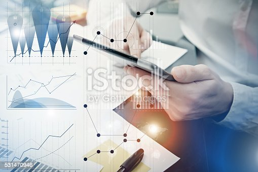 533699494istockphoto Banker manager working process.Photo analyst trader work market charts 531470946