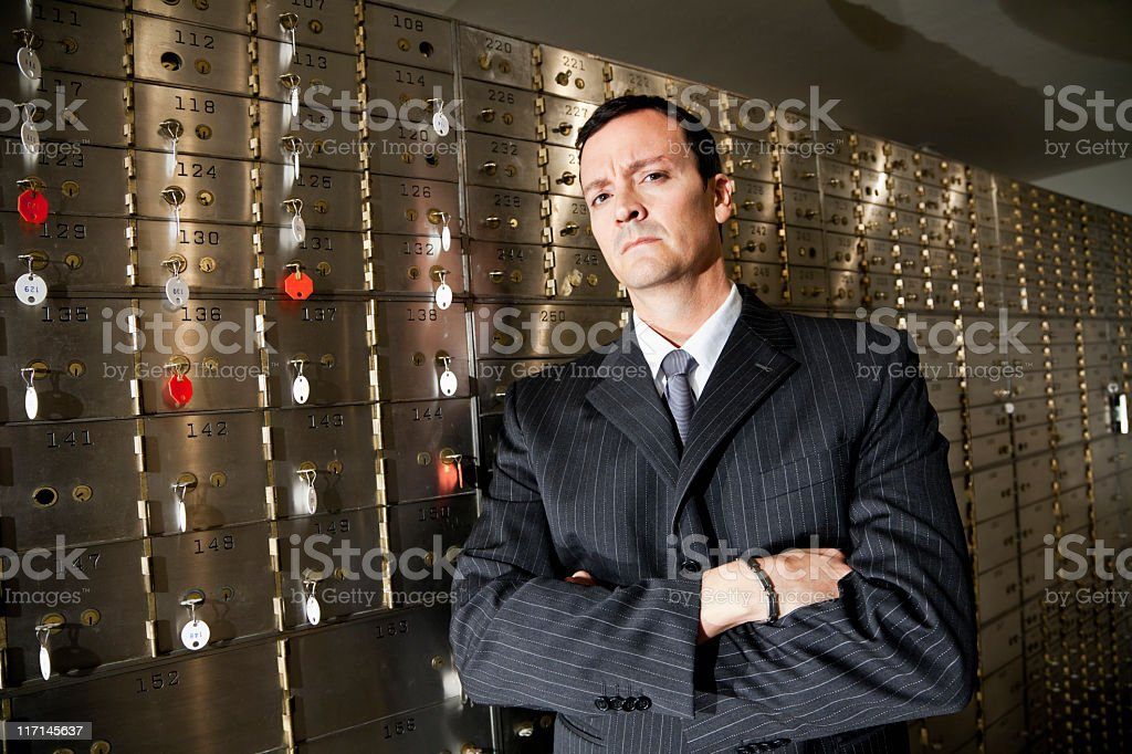 Banker with safety deposit boxes stock photo