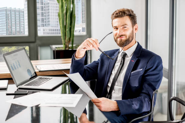 banker working at the office - bankers stock photos and pictures