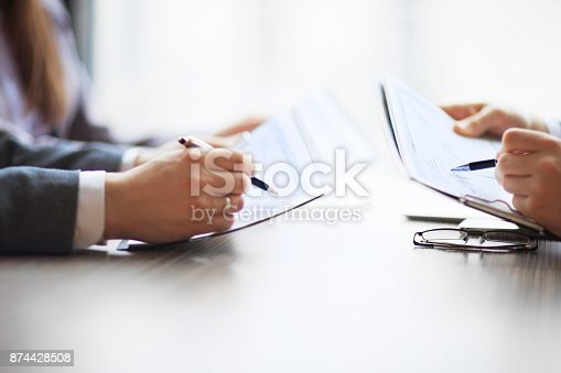 istock Banking business in financial analyst desktop accounting charts, pens indicates graphics 874428508