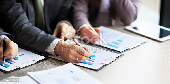 istock Banking business or financial analyst desktop accounting charts, pens indicates in the graphics 874780574