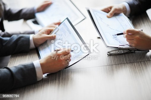 istock Banking business or financial analyst desktop accounting charts 958682794