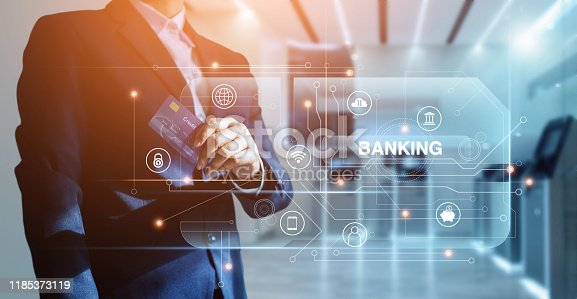 812948018istockphoto Banking network, Businessman and credit card in hand and word banking with icon network connection on virtual screen, online payment, financial futuristic and technology 1185373119